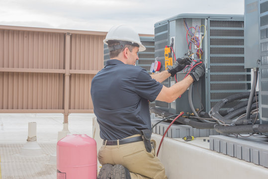 HVAC Tech Checking Condenser