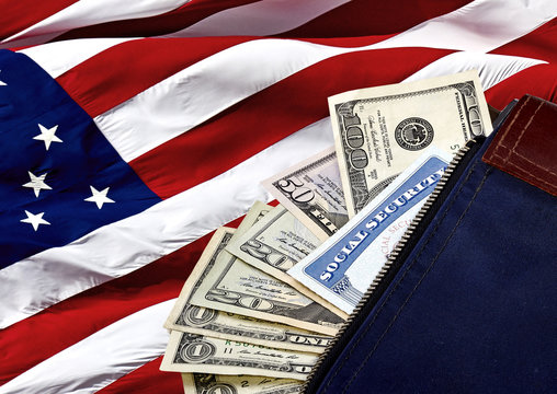 Social Security Card and US Currency on an American Flag