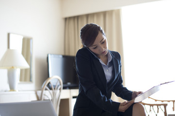 Women are busy working also in the hotel business trip destination