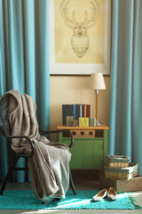 Design interior with wicker chair and wooden nightstand indoors