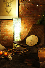 Cozy design interior with chair and light of lamp against brick wall background