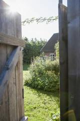 Open door with house in background
