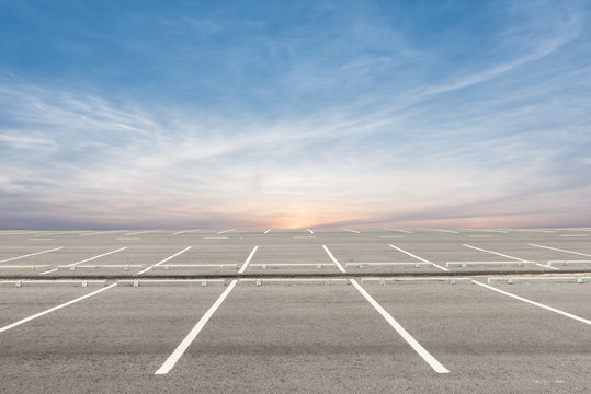 Empty parking lot on sunset background