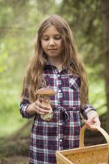 Girl holding mushroom and basket