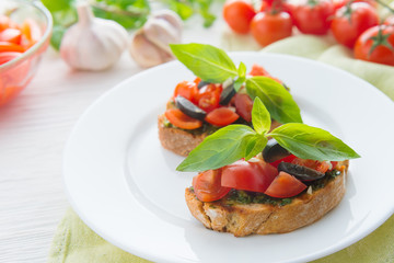 Italian tomato bruschetta with chopped vegetables, herbs and oil