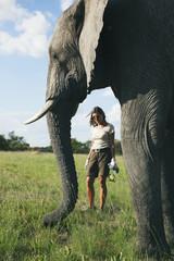 Woman with elephant in safari camp