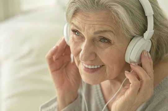 senior woman in headphones