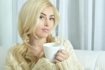young beautiful woman  drinking tea