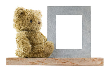Side profile of a cute bear sitting next to blank metal picture frame made of real silver, isolated on white background