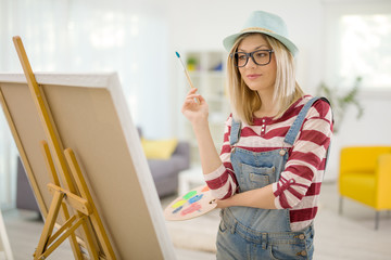 Young woman drawing a painting