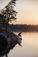 Swimmer at water, sunset