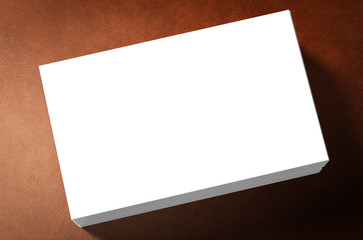 stack of white blank name card on leather background