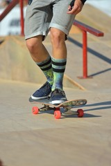 Closeup View of a Skateboarder Doing some Tricks