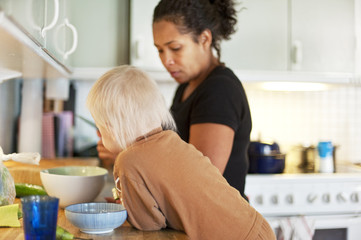 Mother with son preparing meal