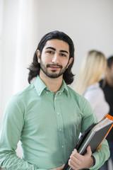 Young man looking at camera