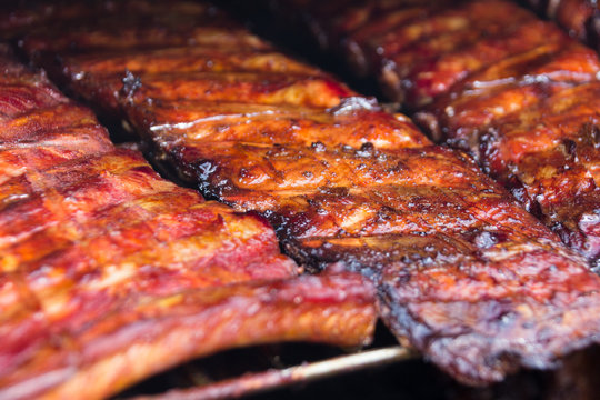 Spare ribs on grill - smoked pork ribs