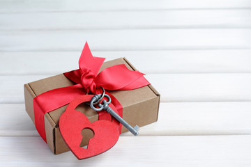 gift from the heart/gift with ribbon and heart symbol with a key
