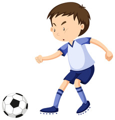 Boy playing soccer alone