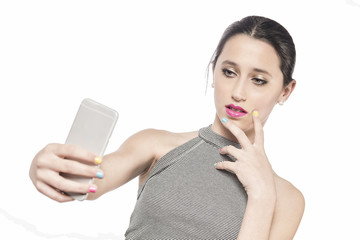 Cute teen taking a photo of herself