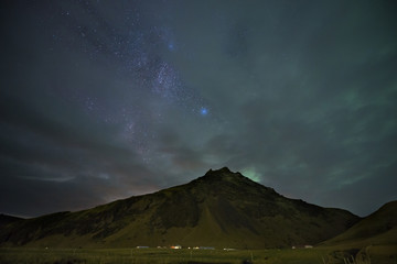Iceland, Northern lights and milky way at cloudy night