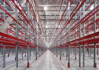 Industrial racks pallets shelves in huge empty warehouse interior.  Storage equipment.