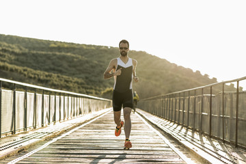 Runner training on a bridge