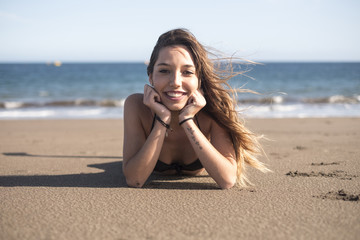 Spain, Tenerife, portrait of young woman relaxing on the beach