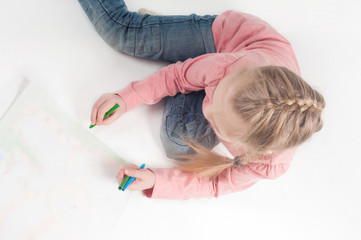 View from above to drawing little girl