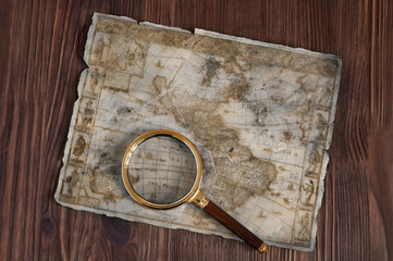 Old map and magnifying glass