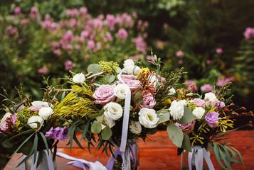 Beautiful fresh wedding bouquet in glass vase closeup