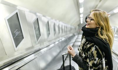 Young woman on subway escalators