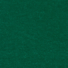 Emerald green wool knitted fabric texture. Close up fragment of the top view.