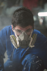 Portrait of a construction worker with protective mask