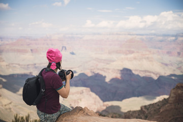 USA, Arizona, Young tourist taking pictures in Grand Canyon