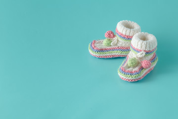 baby shoes on aquamarine background
