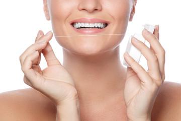 Woman and dental floss