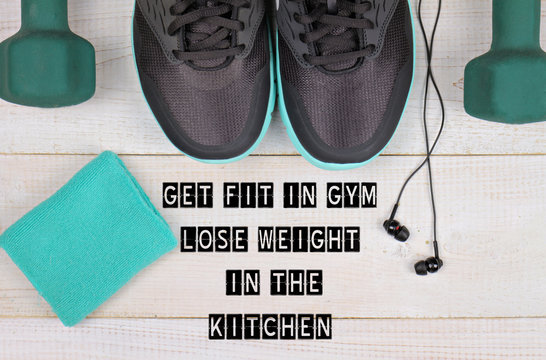 Motivation inspirational quote get Fit in Gym, lose Weight in the Kitchen.Woman workout concept. Sport, Fitness background.