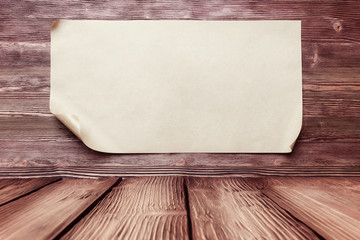 Empty paper on old wooden background