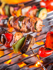 Grilled skewers and vegetables, close-up.