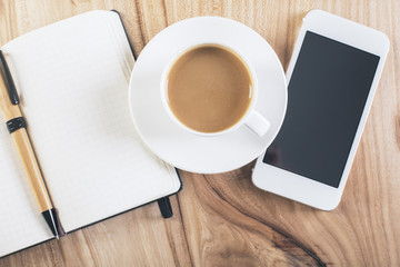 Coffee, smartphone and notepad