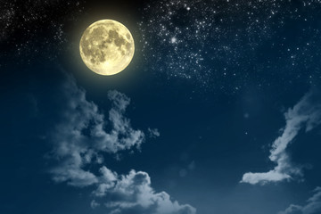 Beautiful magic blue night sky with clouds and fullmoon and stars Wall mural