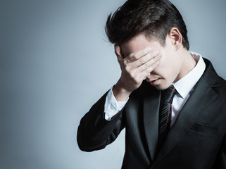 Feeling sad. Stressed out businessman.