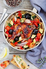 Roasted chicken leg with seasonal vegetables  . Healthy eating concept.Selective focus