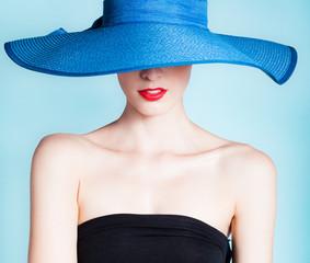 Fashion portrait of woman wearing hat.
