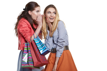 shopping, sale and gifts concept - two smiling teenage girls wit