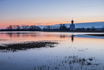 Spring landscape in the early morning with the tide in the vicinity of the temple of the Intercession on the Nerl in Vladimir region in Russia
