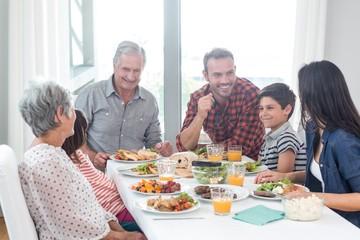 Happy family having breakfast