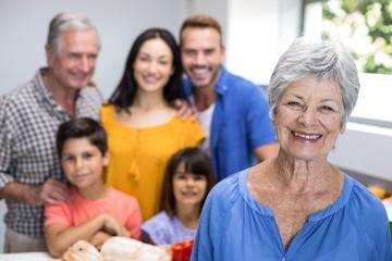 Elderly woman standing in kitchen