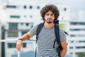 Portrait of young man standing on terrace