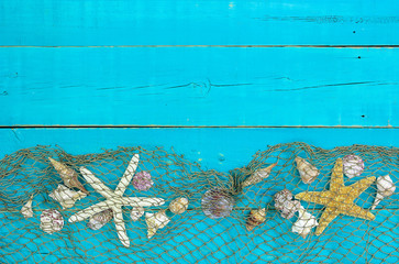 Blank blue wood sign with seashells and fish net border